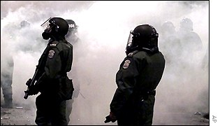 Teargas and police during protests at the summit