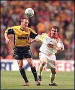 Arsenal's Lee Dixon and Gheorghe Hagi of Galatasaray
