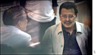 Imprisoned former Philippines President Joseph Estrada with his lawyer, Rene Saguisag, left