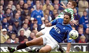 Celtic's Tommy Johnson is challenged by Lorenzo Amoruso