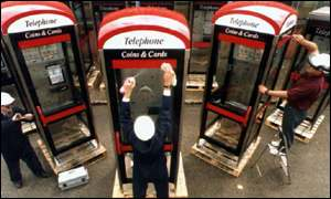 BT workers cleaning phone boxes