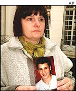 Mr Eboli's mother with a photo of him