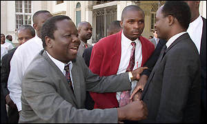 Morgan Tsvangirai celebrates outside the High Court
