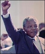 Mandela on release from prison raises clenched fist