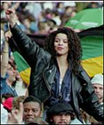 [ image: Fans at a concert for Nelson Mandela in Wembley, England]
