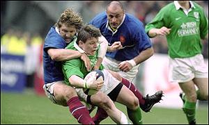 Franck Tournaire (l) of France tackles Brian O'Driscoll