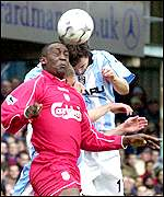 Heskey and Breen battle for the ball