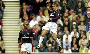 Quinton Fortune and Phil Neville