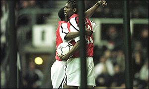 Kanu celebrates the opening goal for Arsenal