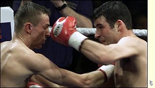 Joe Calzaghe lands a big punch against Mario Veit
