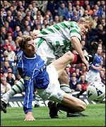 Johan Mjallby (right) battles for the ball with Rangers Tore Andre Flo