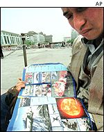 A man reading Chinese news magazine