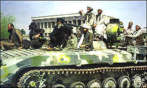 Taleban fighters on tanks