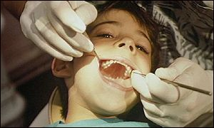 A child being treated by a dentist