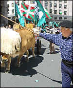 A farmer leads a march through streets of Bilbao