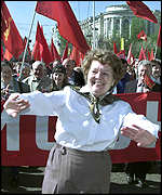 A dancer among demonstrators during Moscow's Communist May Day march