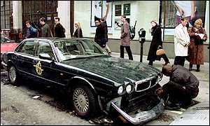 A damaged Jaguar in Great Castle Street
