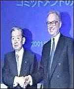 Koichi Sakata, Chairman of Japan Telecom and Chris Gent, Chief Executive of Vodafone