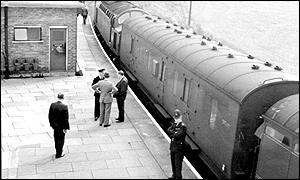 Coaches of the train involved in the 1963 heist under police guard in Cheddington, Buckinghamshire