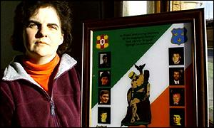 Mairead Kelly with a photo of the eight IRA men killed in an SAS ambush