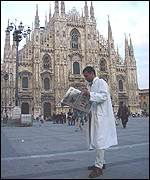 Milan: Julian checks the local media outside the duomo