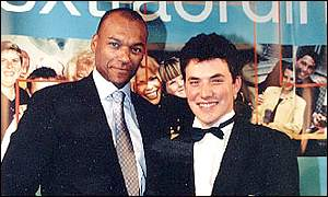 Stuart Strachan (right) collects his commendation award from actor Colin Salmon
