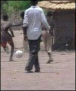Boy soldiers playing football