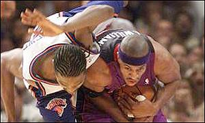 Latrell Sprewell wrestles with Jerome Williams