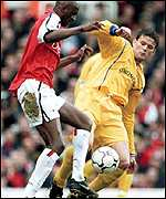 Patrick Vieira scraps for the ball with Eirik Bakke