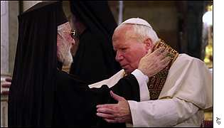Pope John Paul II embraces Syrian Greek-Orthodox Archbishop Agnatios Hazim IV