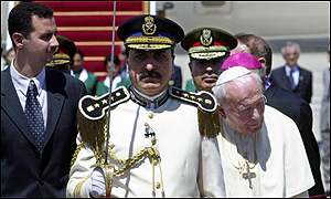 Pope John Paul II reviews a Syrian honour guard on arriving at Damascus airport