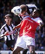 Fulham's Louis Saha (front) challenged by Grimsby Town's Paul Raven