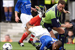 Portsmouth's Kevin Harper (left) tussles with Barnsley's Matthew Appleby