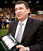 Out-going Watford manager Graham Taylor is presented with a commemorative tankard at Burnley