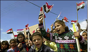 Crowds of children wait to welcome the Pope to Quneitra
