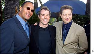 Fraser (right) with wrestler The Rock and writer-director Stephen Sommers