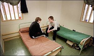 Two inmates in a prison cell