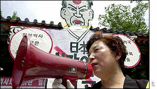 A protester speaks through a megaphone during an anti-Japan campaign in Seoul, South Korean