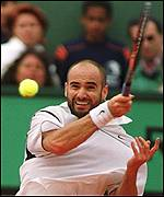 Andre Agassi returns the serve