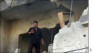 A Palestinian man searches the damaged offices