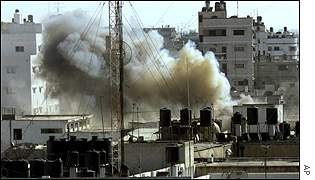 Smoke rises from the Gaza City police headquarters