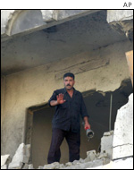 A Palestinian inspects a building damaged in a raid on Thursday