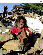 Girl sits in rubble