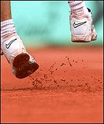 Andre Agassi's shoes kick up the clay surface