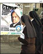 Nuns with election poster