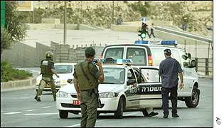 Israeli police block the road after a bomb explosion by Jerusalem's Jaffa Gate