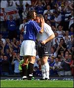 Amoruso plants a kiss on McCoist after the game