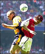 Murphy and Ljungberg collide
