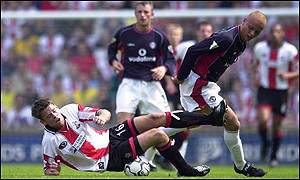 James Beattie is dumped on the floor by Wes Brown