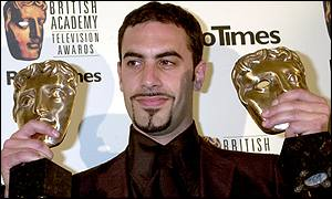 Sacha Baron Cohen with his awards